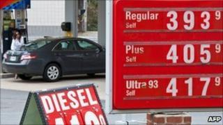 Motorist filling her car at a petrol station in Virginia