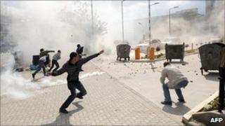 Rioters hurl stones at police in Pristina as tear gas is fired, 12 May