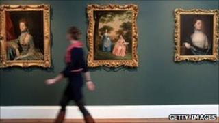 Woman walking past paintings at Holburne Museum