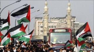 "Egyptians wave Palestinian flags during a ""Nakba"" demonstration in front of the Israeli embassy in Cairo on 15 May 2011"