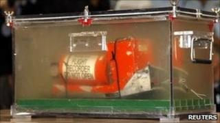 The cockpit voice recorder, preserved in a tank of demineralised water, is displayed in Paris, 12 May
