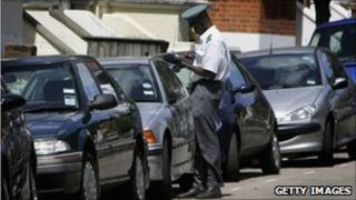 Parking warden and parked cards