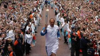 Sir Steve Redgrave with the Olympic torch
