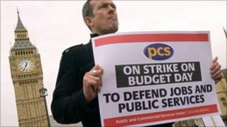 Protestors from the Public and Commercial Services Union (PCS) demonstrate outside the Houses of Parliament in central London, on March 24, 2010,