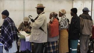 People queue to vote