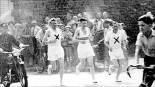 Three runners in the 1948 torch relay.