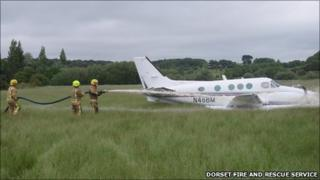 Firefighters spraying the plane