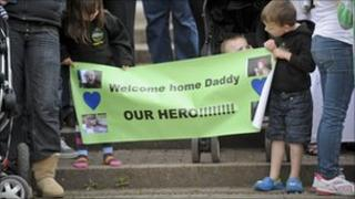 Children welcome their father home