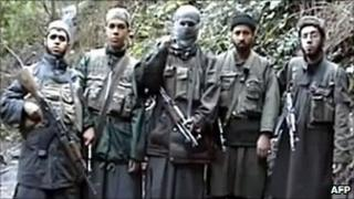Armed youths reported to be members of Al-Qaeda in the Islamic Maghreb (file image)