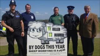 PC Dick Rowlands, Shawn Corin, TDC Animal Welfare Officer Carl Caswell, PCSO John McGovern and Councillor Andrew Eastman with sign