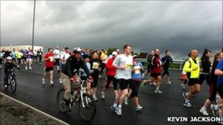 Cyclists, runners and walkers on M74