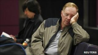 Passenger asleep at Edinburgh Airport