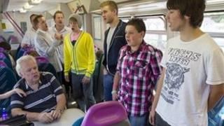 Only Boys Aloud on a train to Ebbw Vale