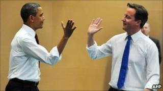 President Barack Obama high-fives with Prime Minister David Cameron