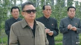 Undated photo of North Korean leader Kim Jong-il inspecting a farm in North Korea