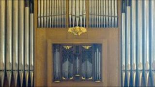 The organ produces sound by driving pressurized air through pipes selected by the keyboard