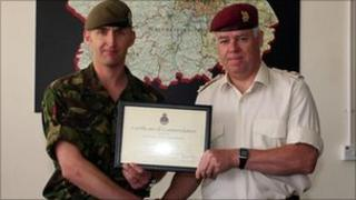 Sgt Stuart Laurie receiving his commendation from Brig Mark Banham