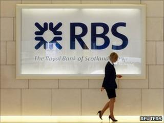 A worker in the foyer of a Royal Bank of Scotland office in London