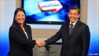 """Keko Fujimori (left) and Ollanta Humala (right) shake hands at the end of the presidential candidates"""" debate in Lima, 29 May 2011"""