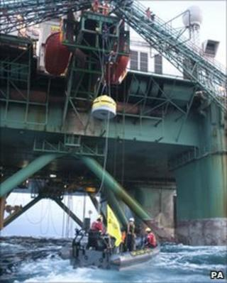 Greenpeace activists board the rig