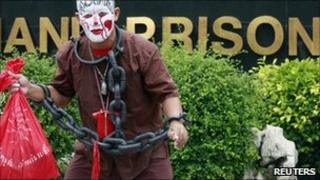 Anti-govt protester wears mock chains to highlight plight of jailed comrades 18 May 2011 Bangkok