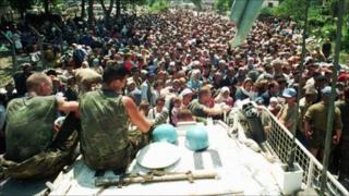 Dutch UN peacekeepers watching Muslim refugee near Srebrenica, on 13 July 1995