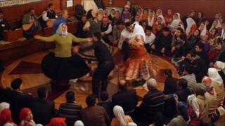 Alevi faithful dance at a religious service in Turkey