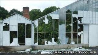 Smashed windows of aviary at Wythenshawe park