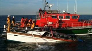 Sinking motorboat alongside lifeboat (Picture by Nicola Thomas)