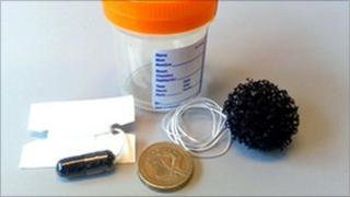 Cytosponge, with pound coin for scale