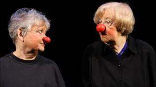 Two pensioners working as clowns