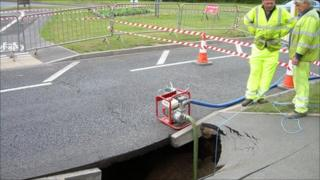 The hole in the pavement