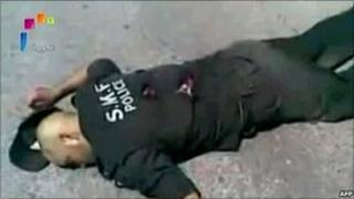 """A grab from footage aired on Syria's state television on 7 June 2011 shows what it said was a policeman shot dead by """"terrorist gangs"""" during a massacre in the town of Jisr al-Shughour on 6 June 2011. NB: Independent reporting on the ground is not allowed, so it is impossible to verify the account of either side."""