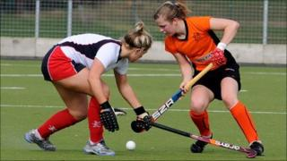 Leicester Ladies Hockey player Lauren Turner (right)
