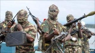 Masked gunmen on a boat in Nigeria
