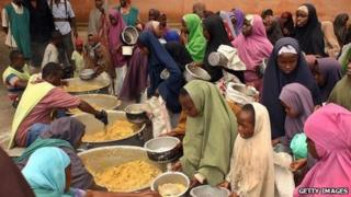 Somalis receive food rations at a distribution centre in 2010.