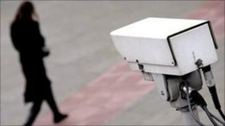 Woman watched by CCTV camera