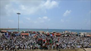 Libyans attend Friday prayers at Revolution Square in Benghazi, 27 May