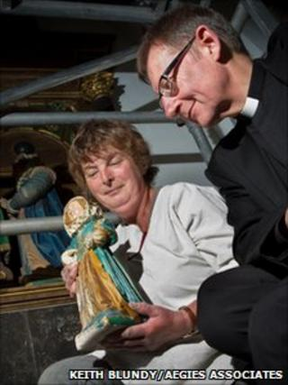 The Dean The Very Reverend Christopher Dalliston and restorer Deborah Carthy with one of the figures. Photo: Keith Blundy/Aegies Associates