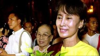 Aung San Suu Kyi walks with friends and family in Yangon