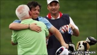 Rory McIlroy celebrates his US Open win with his father Gerry