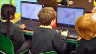 School children with laptops