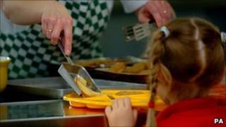 Pupil receives school dinner