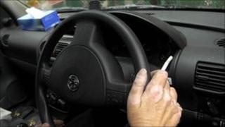 Man smoking in car