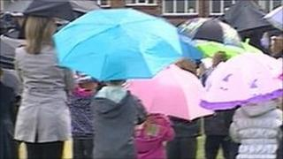 Children and staff doing umbrella dance