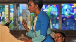 US First Lady Michelle Obama addresses the Young African Women Leaders Forum at the Regina Mundi church in the Soweto township of Johannesburg