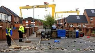 Council workers clean up in east Belfast after two days of rioting