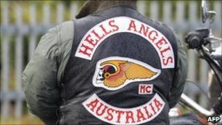 A member of the Hells Angels waits outside during the funeral for Melbourne crime figure Macchour Chaouk at Preston Mosque on August 16, 2010 in Melbourne, Australia