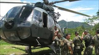 Soldiers board a helicopter in the Ene-Apurimac valley