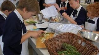 Children peeling vegetables